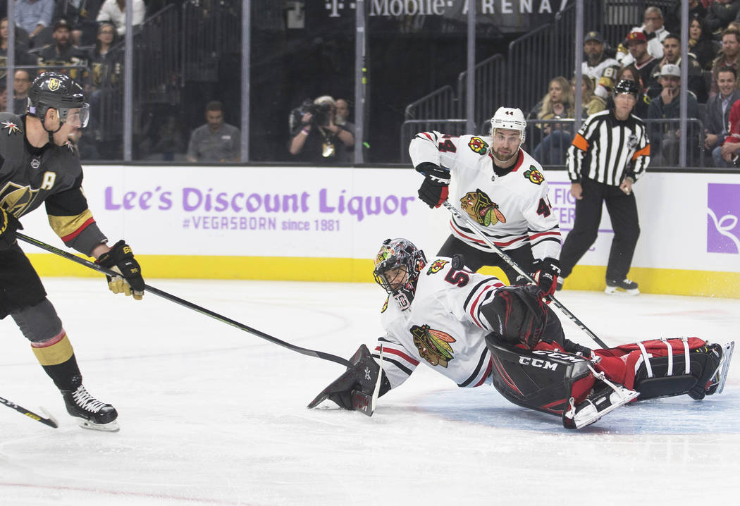 Vegas Golden Knights right wing Reilly Smith (19) shoots on Chicago Blackhawks goaltender Corey ...