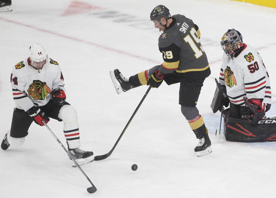 Vegas Golden Knights right wing Reilly Smith (19) tries to deflect a puck past Chicago Blackhaw ...