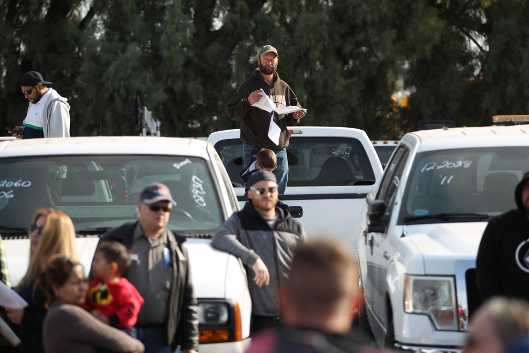 People attend Clark County's fall government auction at the TNT Auction lot in Las Vegas, Satur ...