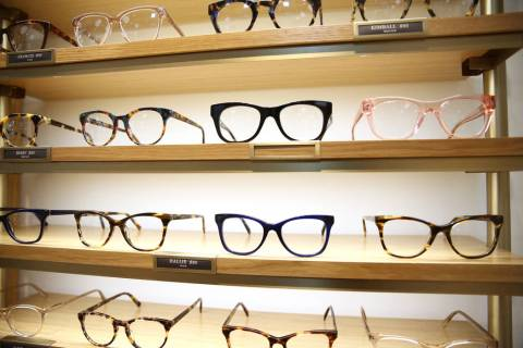 Glasses on display at the new Warby Parker store in Downtown Summerlin in Las Vegas, Thursday, ...
