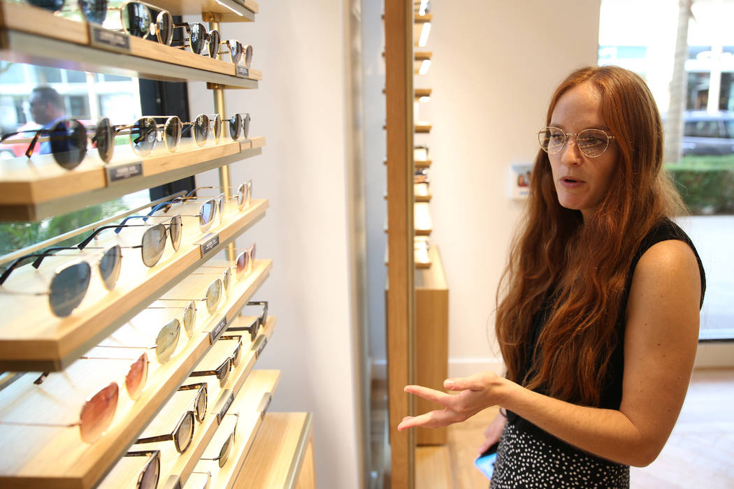 Sara Berlin, social media associate manager for Warby Parker, gives a tour of the new Warby Par ...