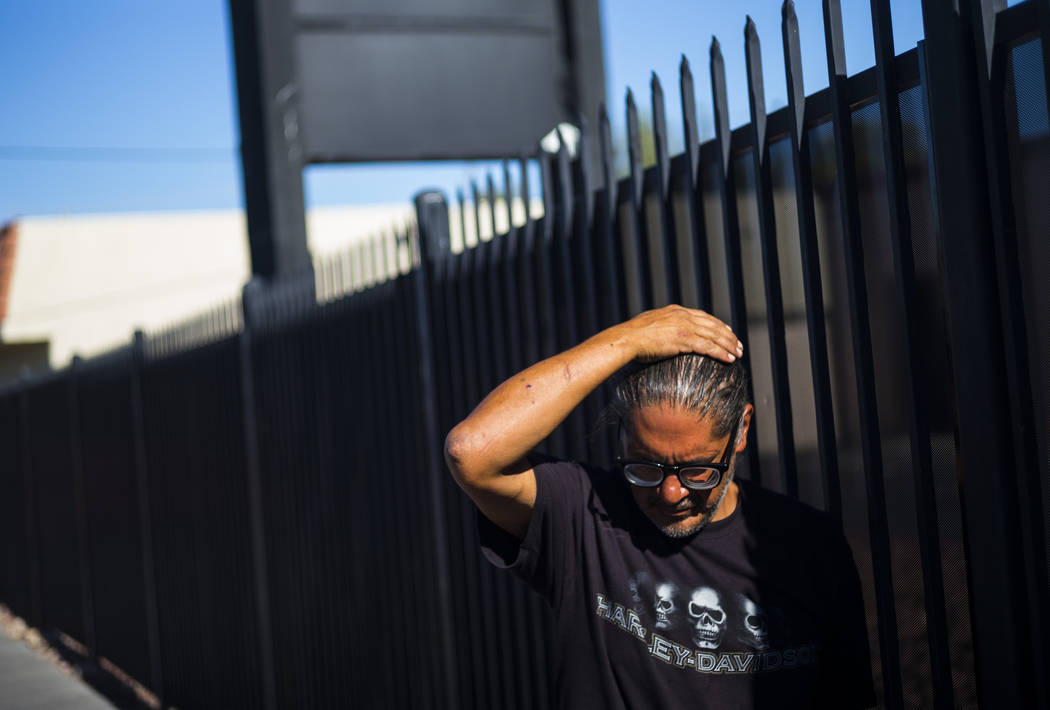 Brian Diaz talks about living homeless while waiting in line for food on Foremaster Lane near d ...