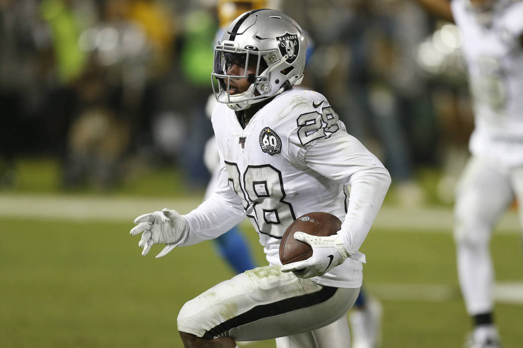 Oakland Raiders running back Josh Jacobs (28) runs toward the end zone to score against the Los ...