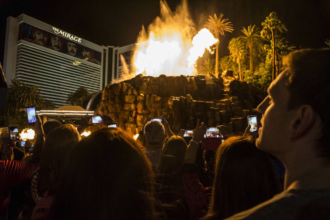 A large crowd gathers to watch the volcano at The Mirage on the Strip on Tuesday, Oct. 11, 2016 ...