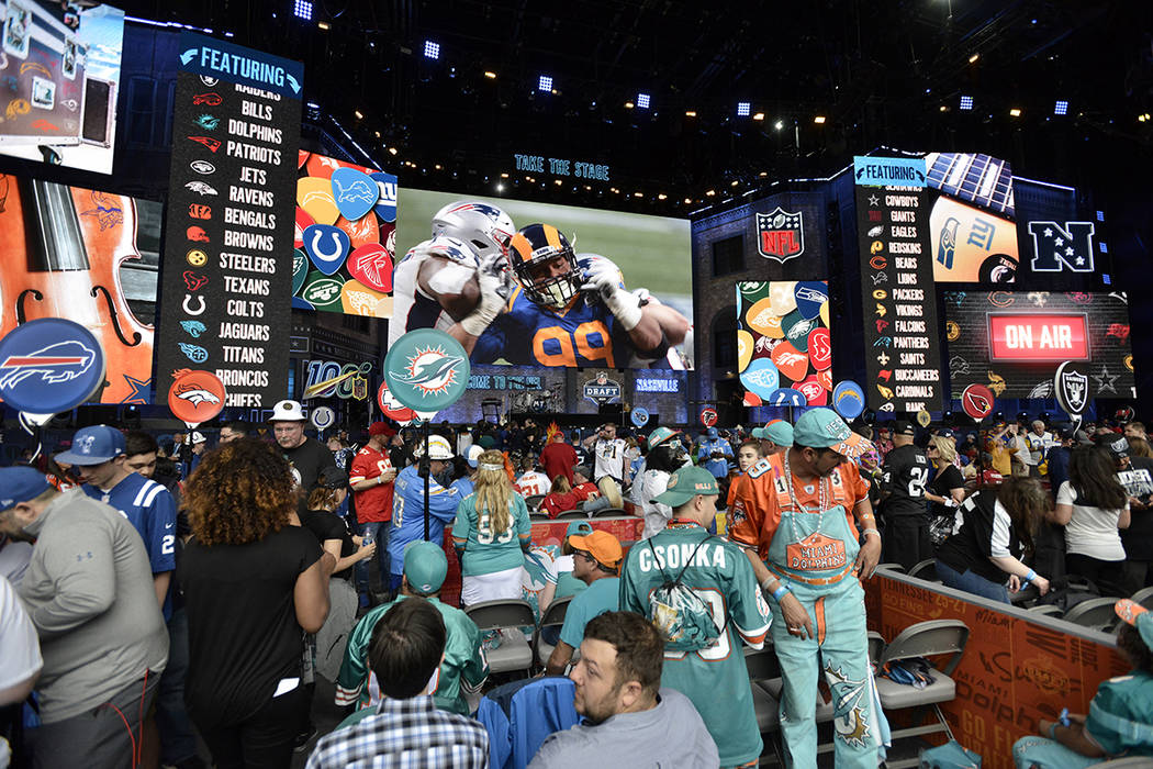 Fans gather in front of the stage during the 2019 NFL Draft Thursday, Apr. 25, 2019, in Nashvil ...