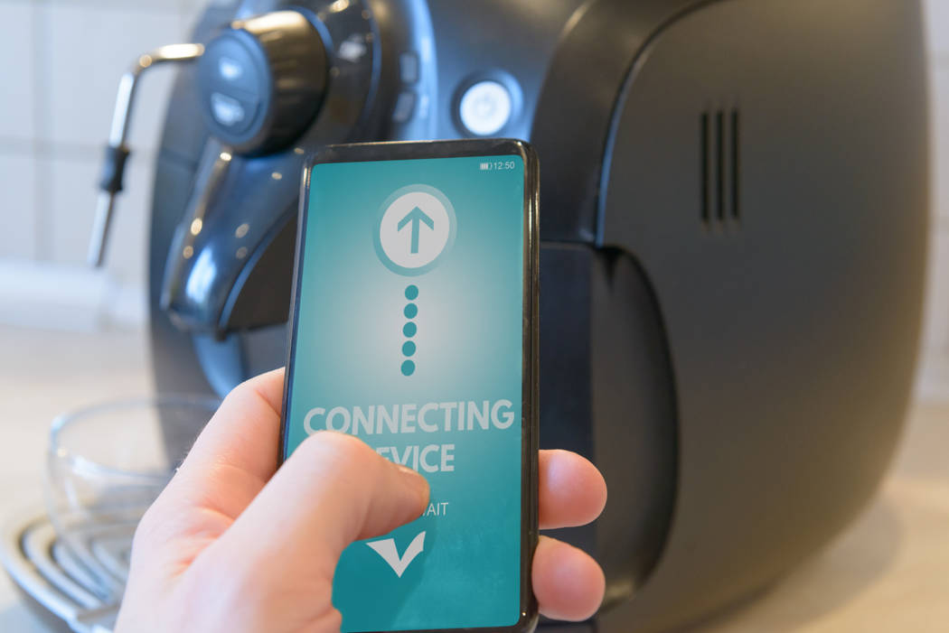 Homeowners can program their coffee machines from their smartphones. (Getty Images)