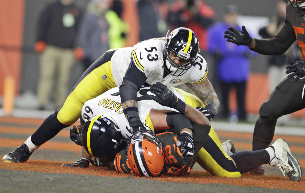 Cleveland Browns defensive end Myles Garrett (95) is punched by Pittsburgh Steelers center Maur ...