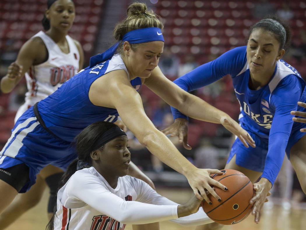 UNLV Lady Rebels forward Anna Blount (12) fights for a loose ball with Duke Blue Devils guard H ...