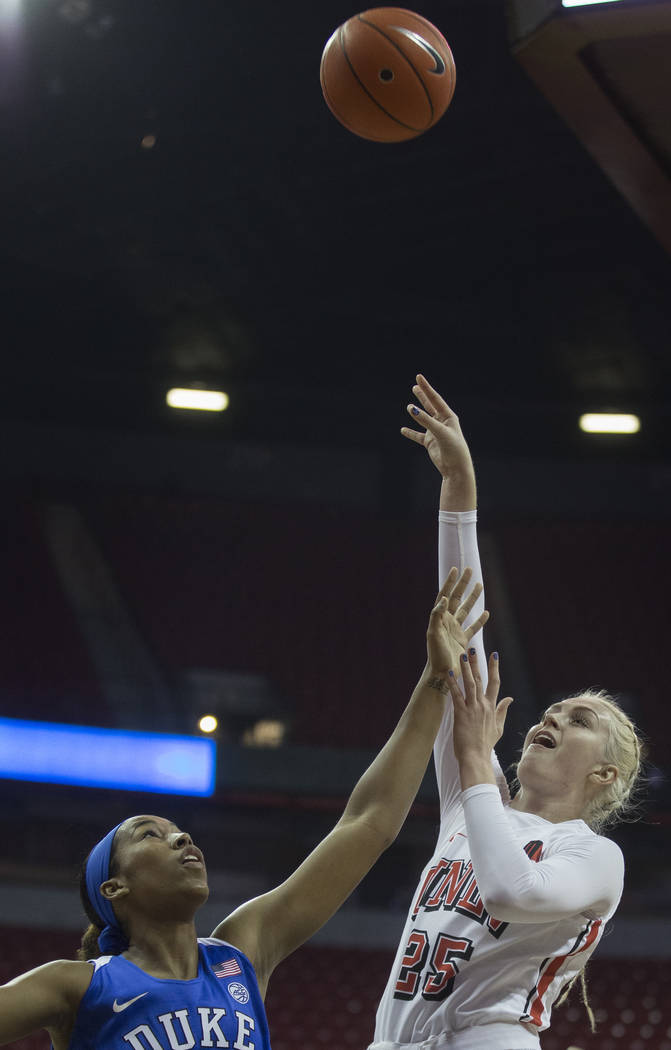 UNLV Lady Rebels guard Krista Jackman (25) shoots a jump shot over Duke Blue Devils guard Azana ...