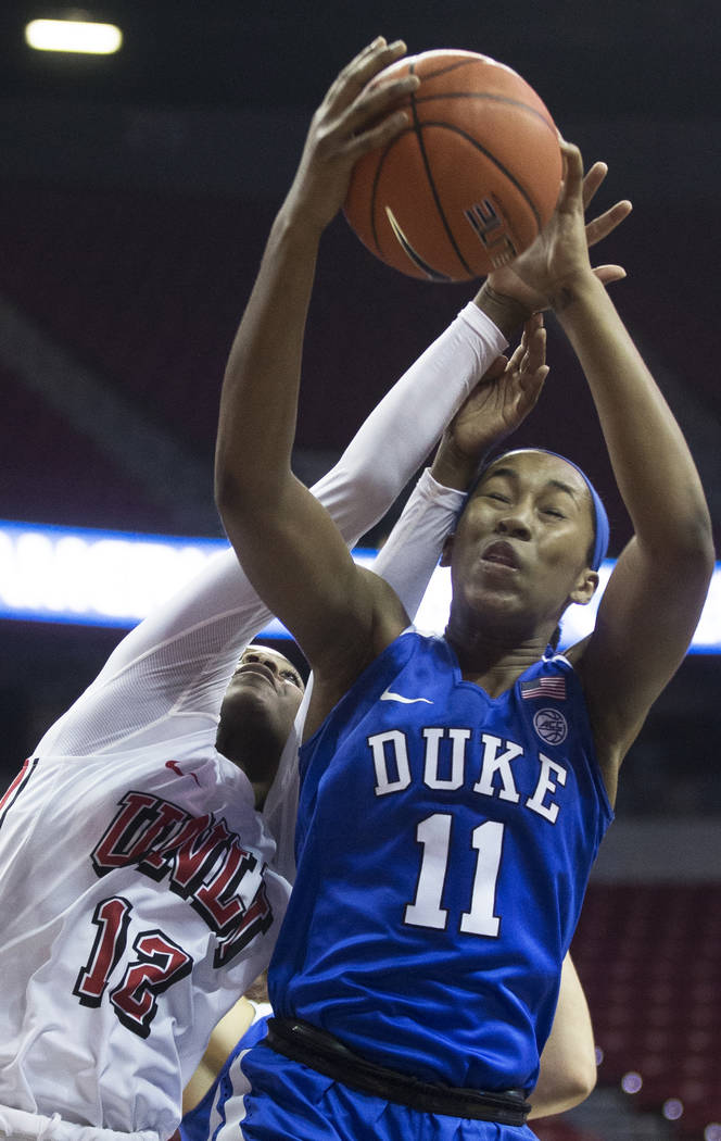 Duke Blue Devils guard Azana Baines (11) fights for a rebound with UNLV Lady Rebels forward Ann ...