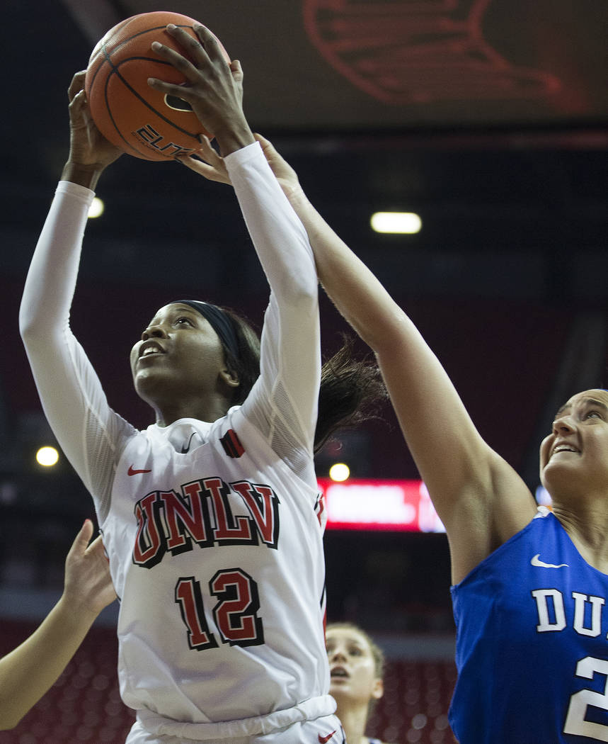 UNLV Lady Rebels forward Anna Blount (12) drives past Duke Blue Devils guard Haley Gorecki (2) ...