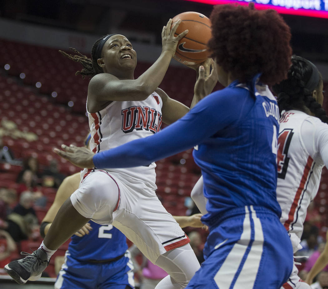 UNLV Lady Rebels guard LaTecia Smith (0) slices to the basket past Duke Blue Devils forward Jad ...