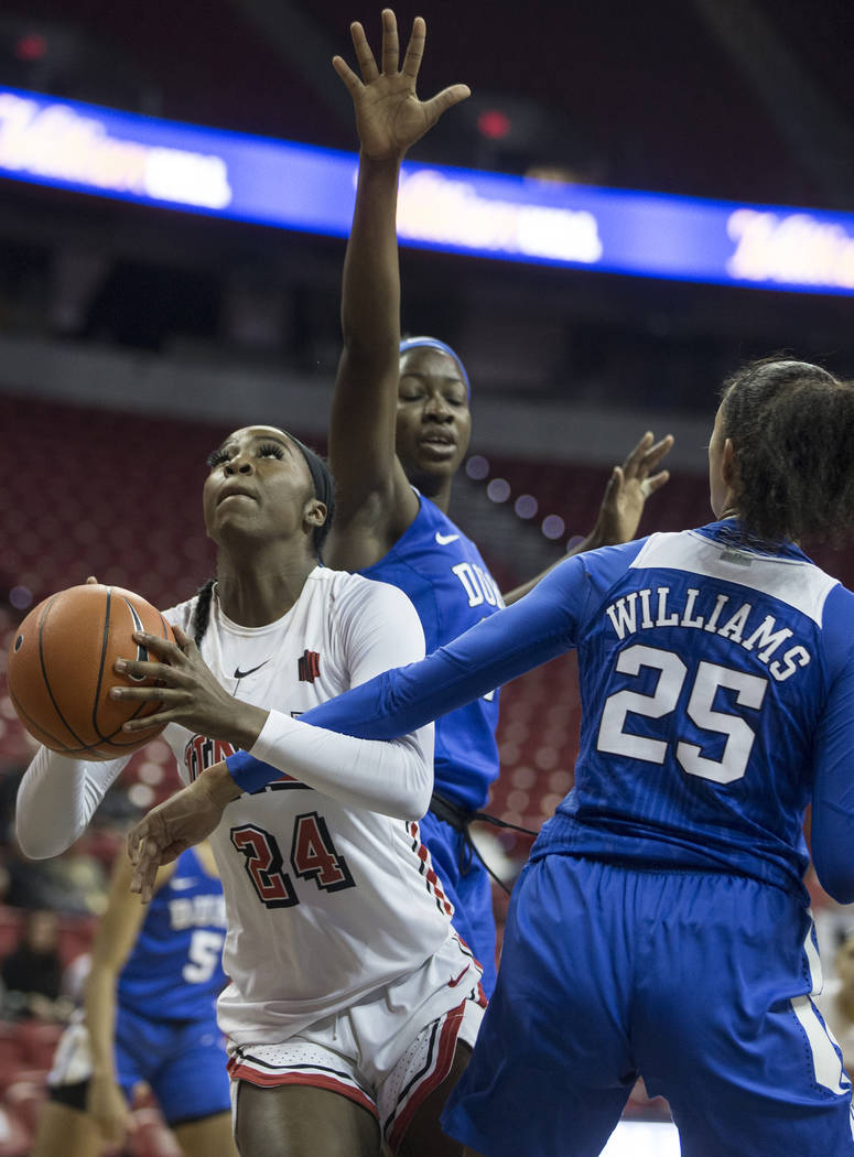 UNLV Lady Rebels guard Rodjanae Wade (24) slices past Duke Blue Devils forward Jade Williams ( ...