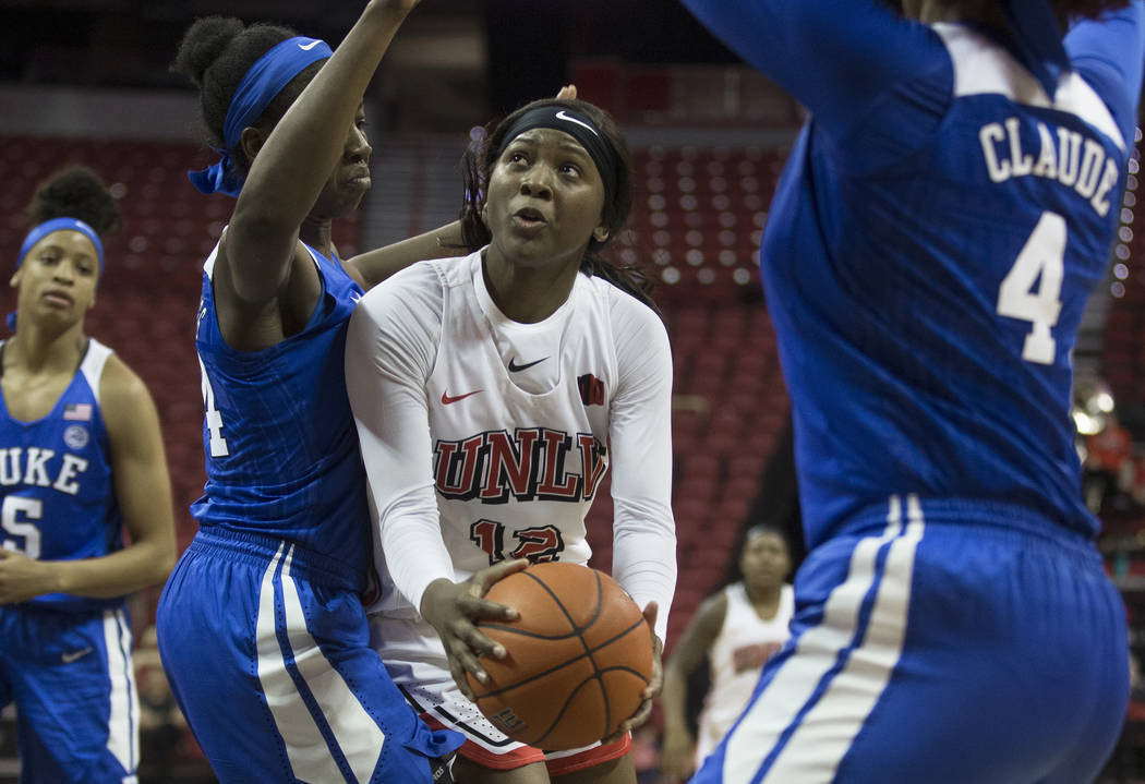 UNLV Lady Rebels forward Anna Blount (12) drives past Duke Blue Devils forward Onome Akinbode-J ...