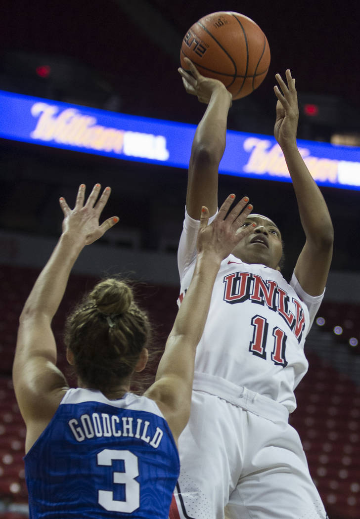 UNLV Lady Rebels guard Justice Ethridge (11) shoots over Duke Blue Devils guard Miela Goodchild ...