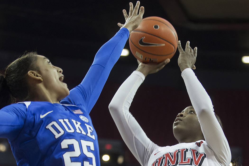 UNLV Lady Rebels forward Anna Blount (12) shoots over Duke Blue Devils forward Jade Williams (2 ...