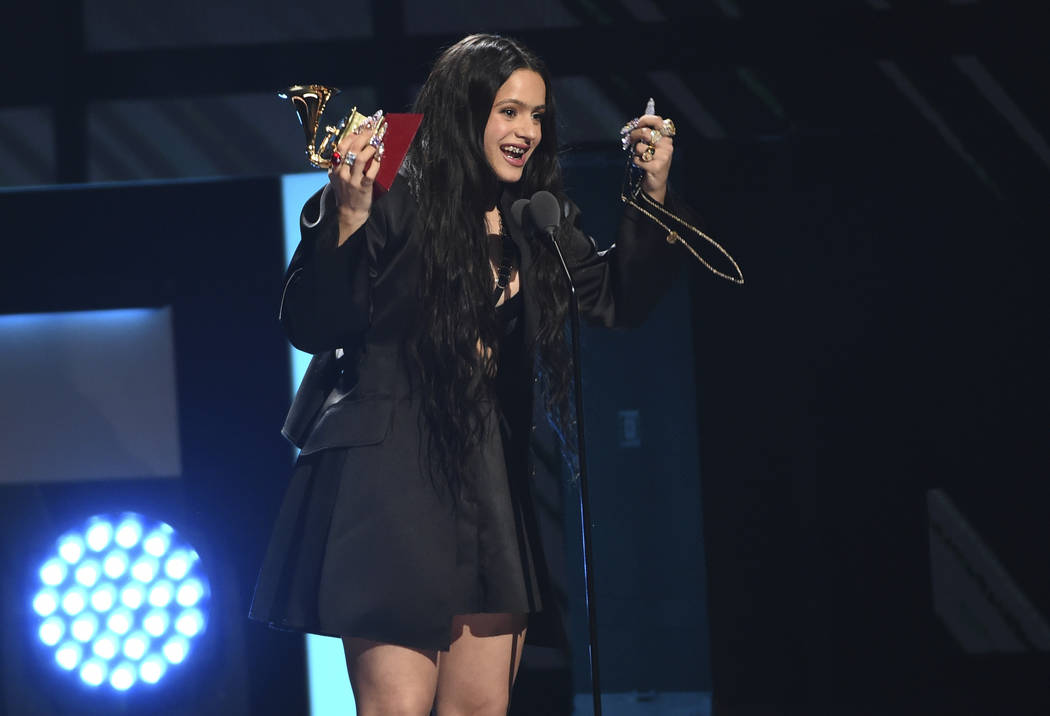 """Rosalia accepts the award for album of the year for """"El Mal Querer"""" at the 20th Latin ..."""
