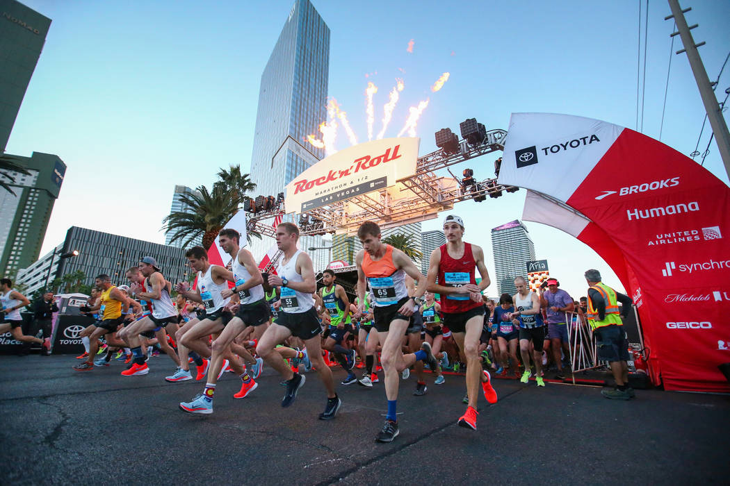 Runners take off from the starting line during the 2018 Rock 'n' Roll Marathon on the Strip in ...