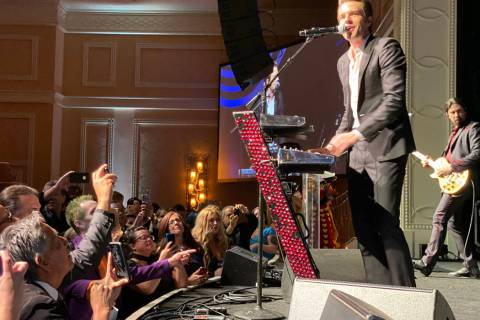 Brandon Flowers, left, and Ted Sablay of The Killers perform at The Neon Museum's annual Boneya ...