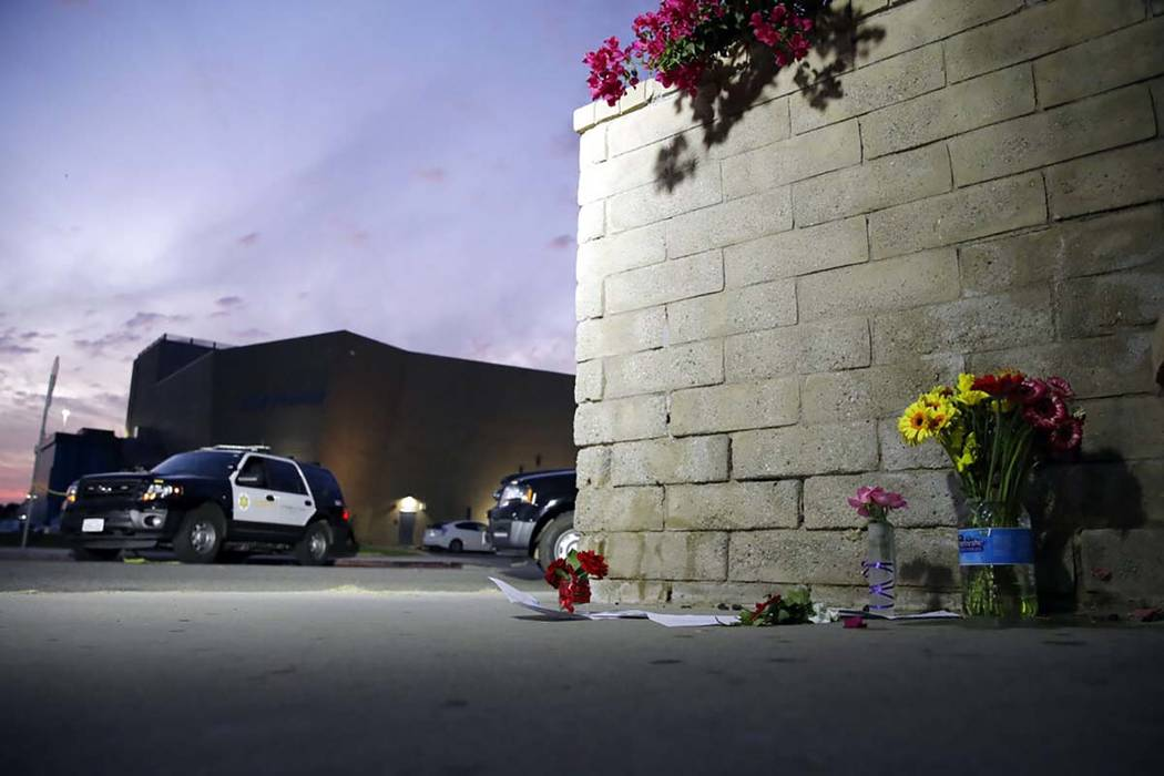 Flowers are placed in front of Saugus High School in the aftermath of a shooting on Thursday, N ...