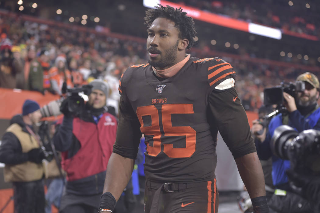Cleveland Browns defensive end Myles Garrett walks off the field after he was ejected late in t ...