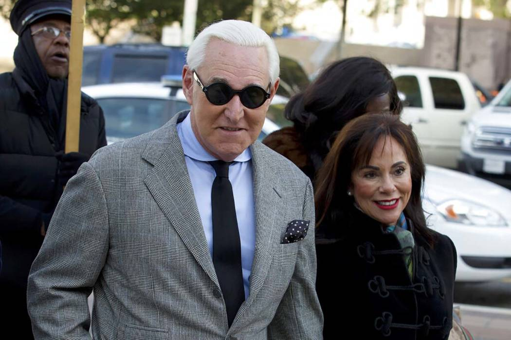 Roger Stone accompanied by his wife Nydia Stone, right, arrives at federal court in Washington, ...