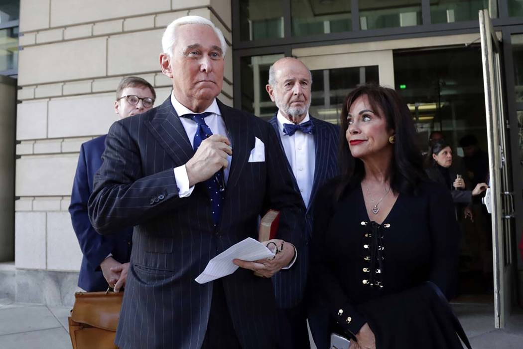 Roger Stone, left, with his wife Nydia Stone, leaves federal court in Washington, Friday, Nov. ...