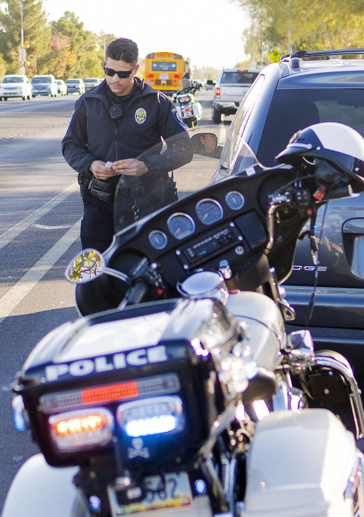 """Officer Chris Lourenco of """"Fab Five,"""" the five-member traffic unit of Clark County S ..."""