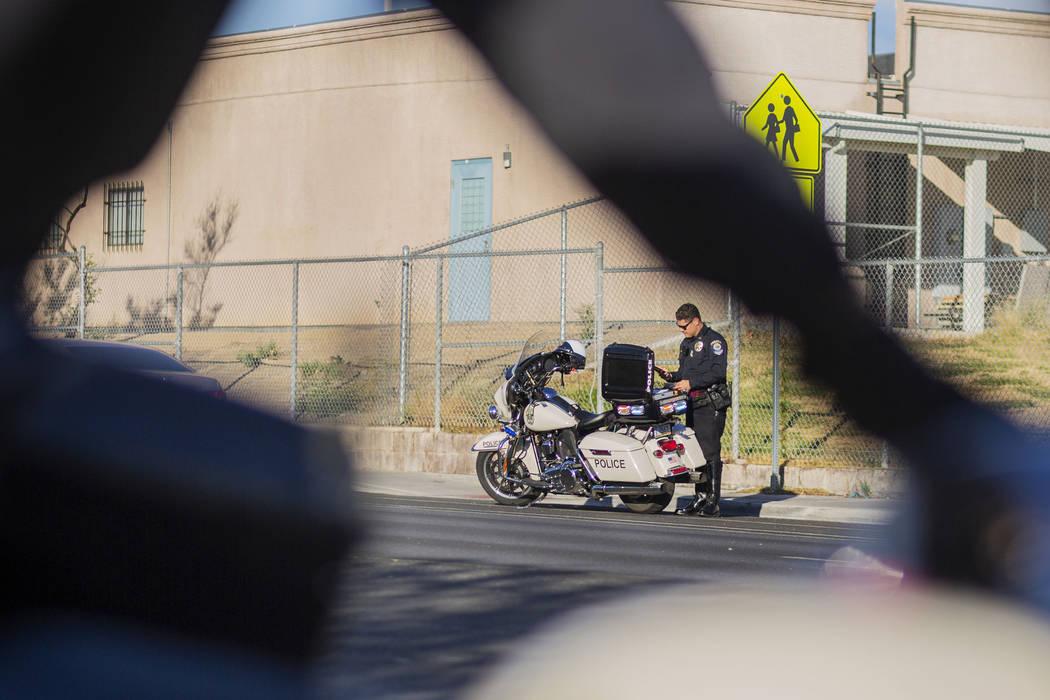 "Officer Chris Deuel of ""Fab Five,"" the five-member traffic unit of Clark County Schoo ..."