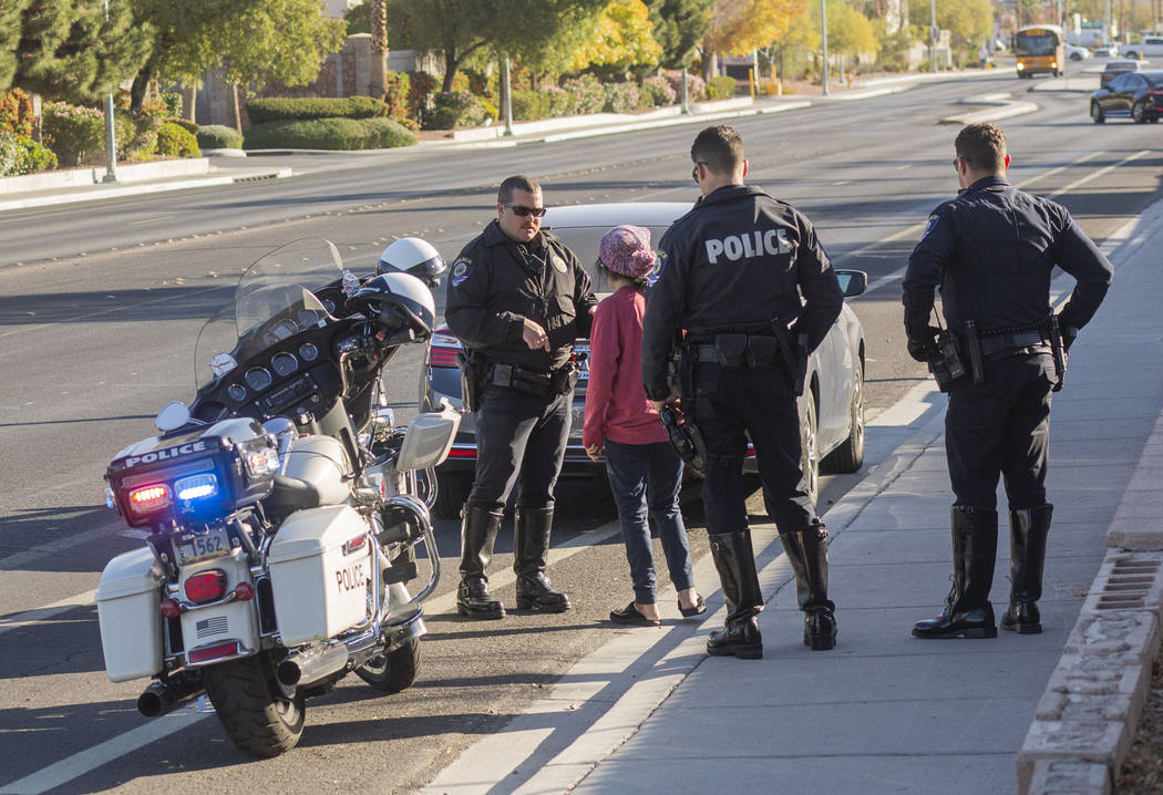 """Officer Shane Barton of """"Fab Five,"""" the five-member traffic unit of Clark County School Distri ..."""