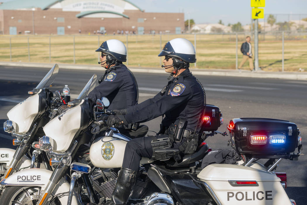 """Officers Shane Burton, left, and Chris Lourenco, both from """"Fab Five,"""" the five-membe ..."""