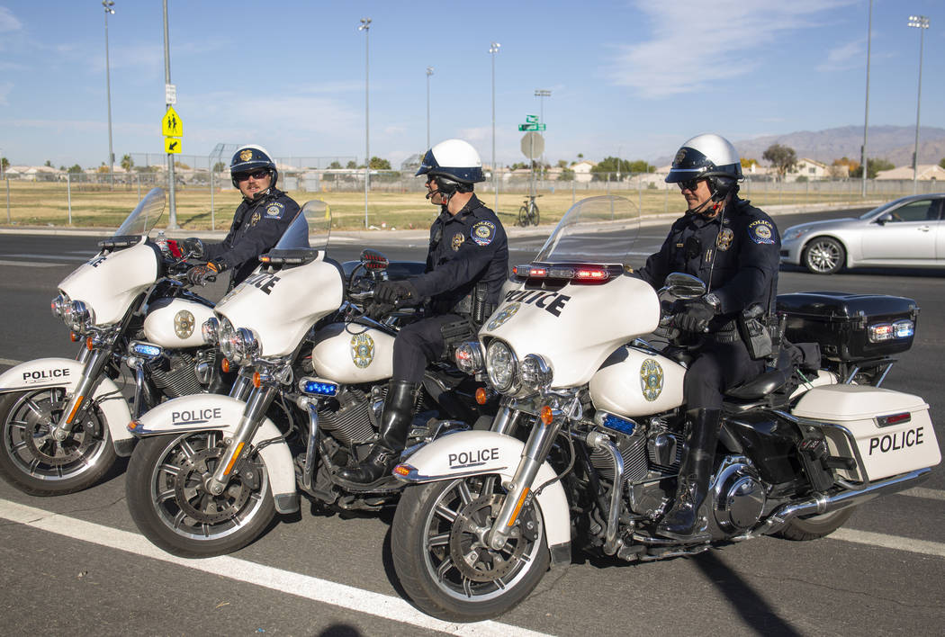 """Officers Shane Burton, left, and Chris Lourenco, center, and Chris Deuel, from """"Fab Five, ..."""