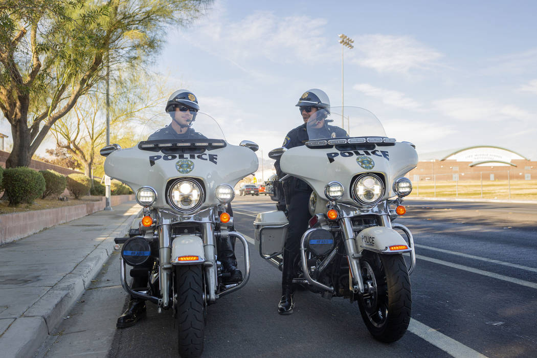 """Officers Chris Lourenco, left, and Chris Deuel, from """"Fab Five, """"the five-member traf ..."""