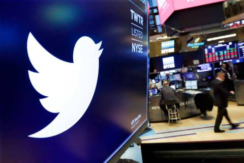 In a Feb. 8, 2018, file photo, the logo for Twitter is displayed above a trading post on the fl ...