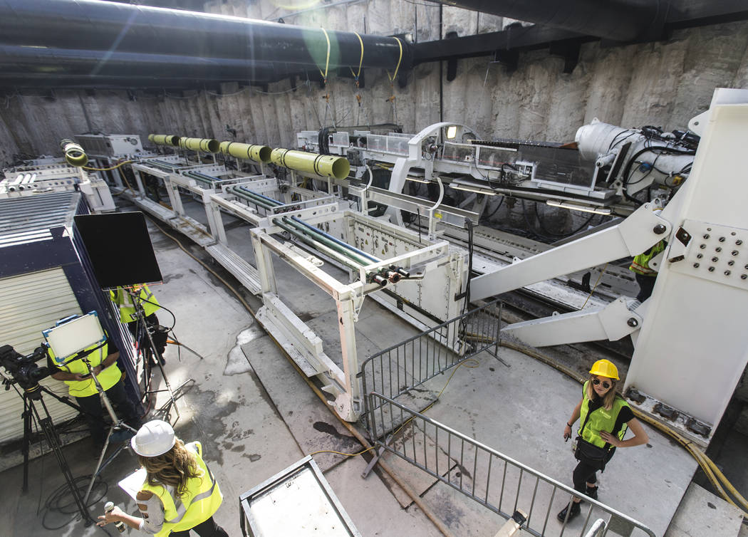 Media get a first glimpse at a tunnel boring machine at the future location of an underground p ...