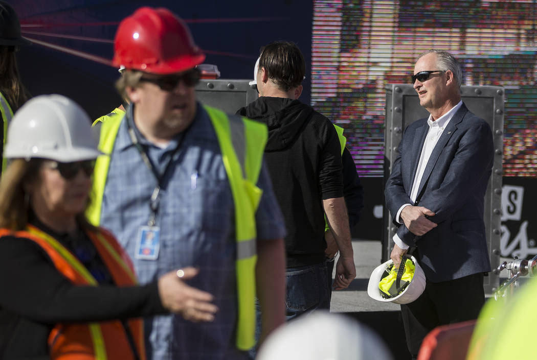 Steve Hill, right, Chief Executive Officer of the Las Vegas Convention and Visitors Authority, ...