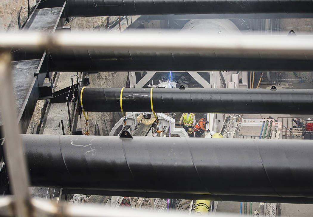 The tunnel boring machine begins work at the future location of one of the underground people m ...