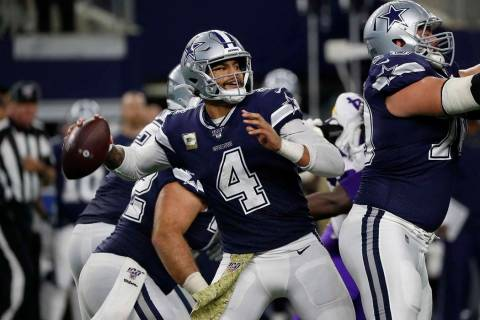 Dallas Cowboys quarterback Dak Prescott throws the ball during the second half of an NFL footba ...