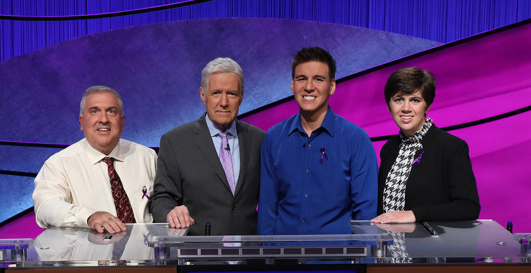 "From left, Francois Barcomb of New York, ""Jeopardy!"" host Alex Trebek, James Holzhauer of L ..."