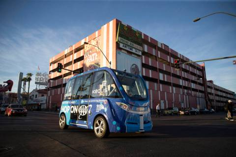 A self-driving vehicle tours people in downtown Las Vegas near the Container Park, Thursday, No ...