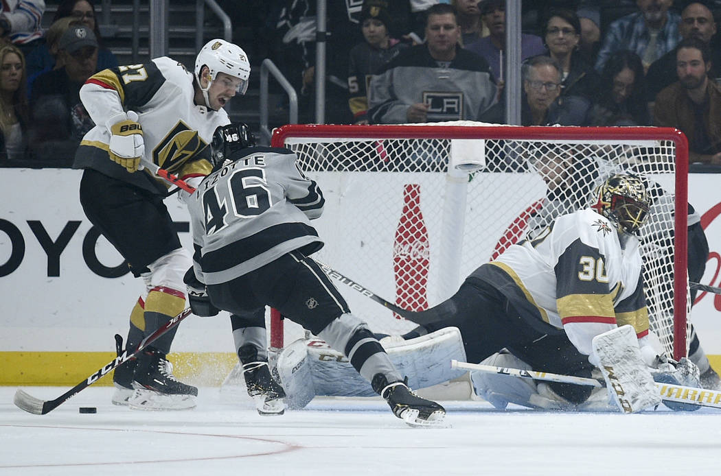 Los Angeles Kings center Blake Lizotte, second from left, shoots the puck for a short-handed go ...