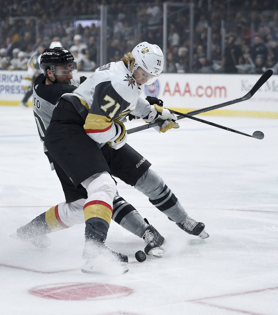 Vegas Golden Knights center William Karlsson, right, and Los Angeles Kings center Michael Amadi ...