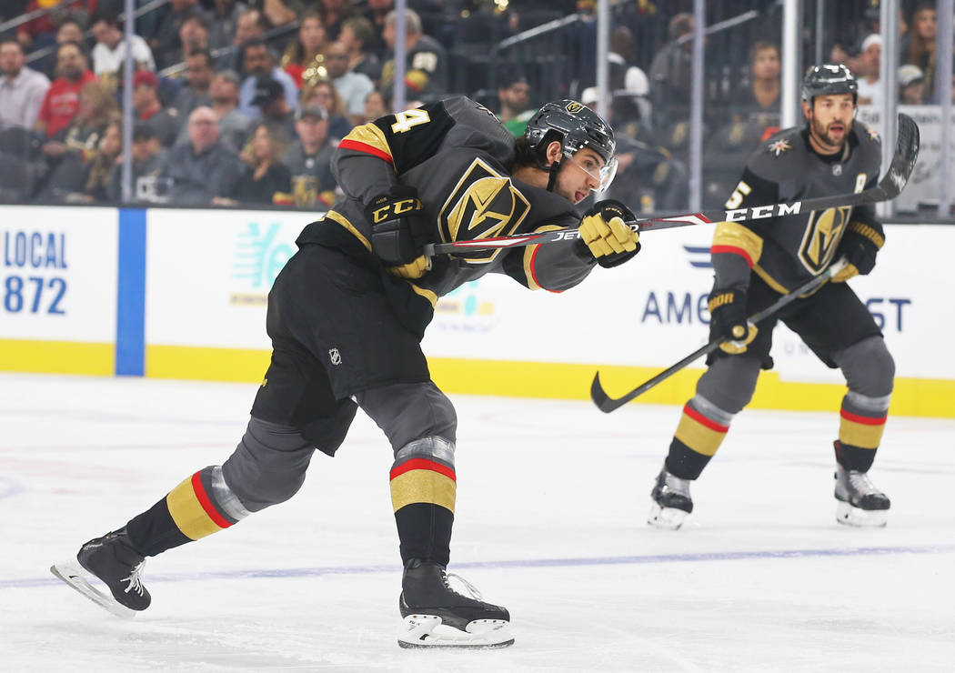 Golden Knights defenseman Nicolas Hague (14) shoots on goal during the first period of Vegas' N ...