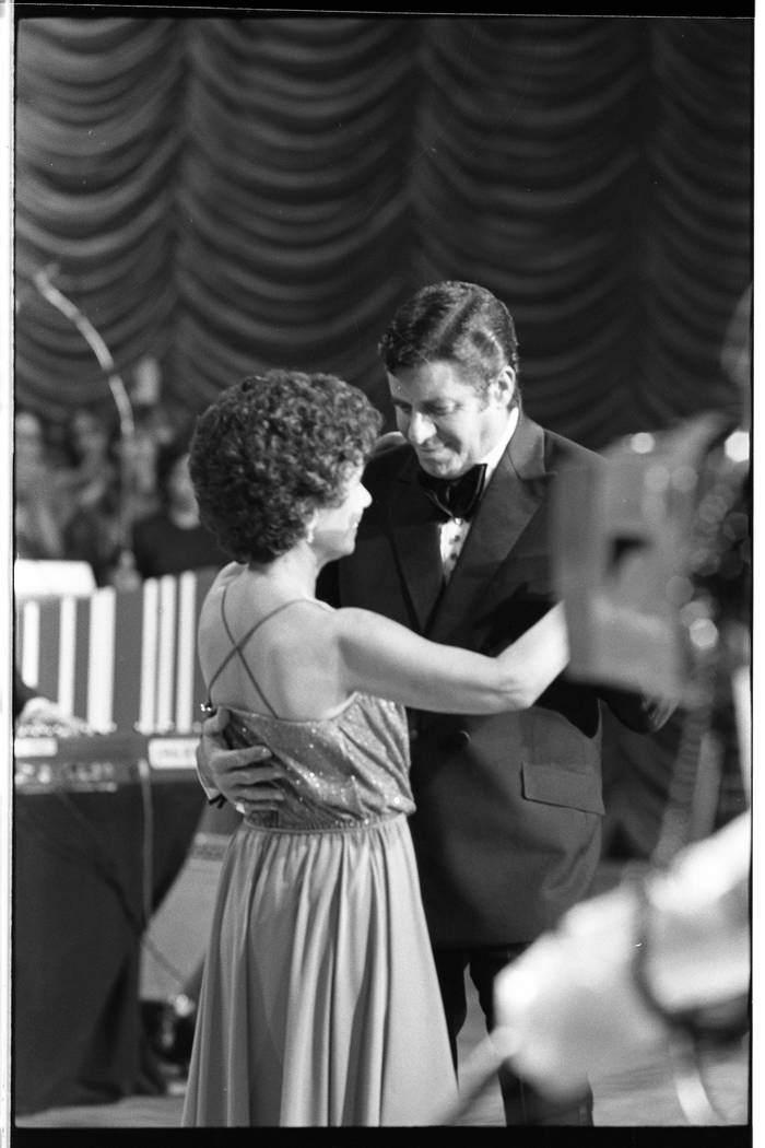 Jerry Lewis dances with an unidentified woman during the 15th annual Jerry Lewis Labor Day Tele ...