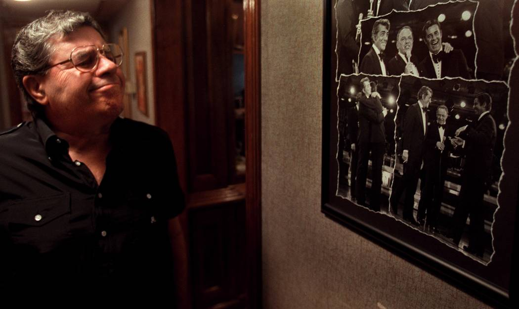 Jerry Lewis looks at photos from the time when Frank Sinatra reunited him with legendary partne ...
