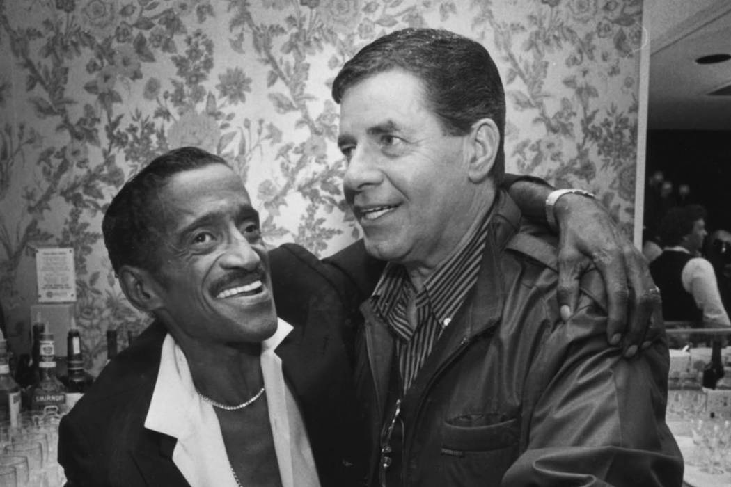 Sammy Davis Jr., and Jerry Lewis are shown on the opening night of their show at Bally's in an ...