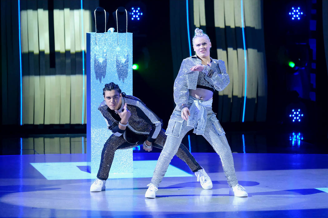 """Top 10 contestants Anna Linstruth (R) and Benjamin Castro (L) perform a Hip-Hop routine to """"L ..."""