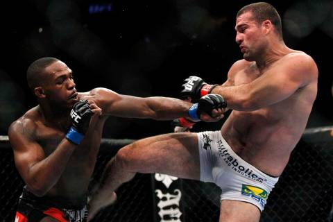 Mauricio Rua, right, kicks Jon Jones during their mixed martial arts match at UFC 128 Saturday ...