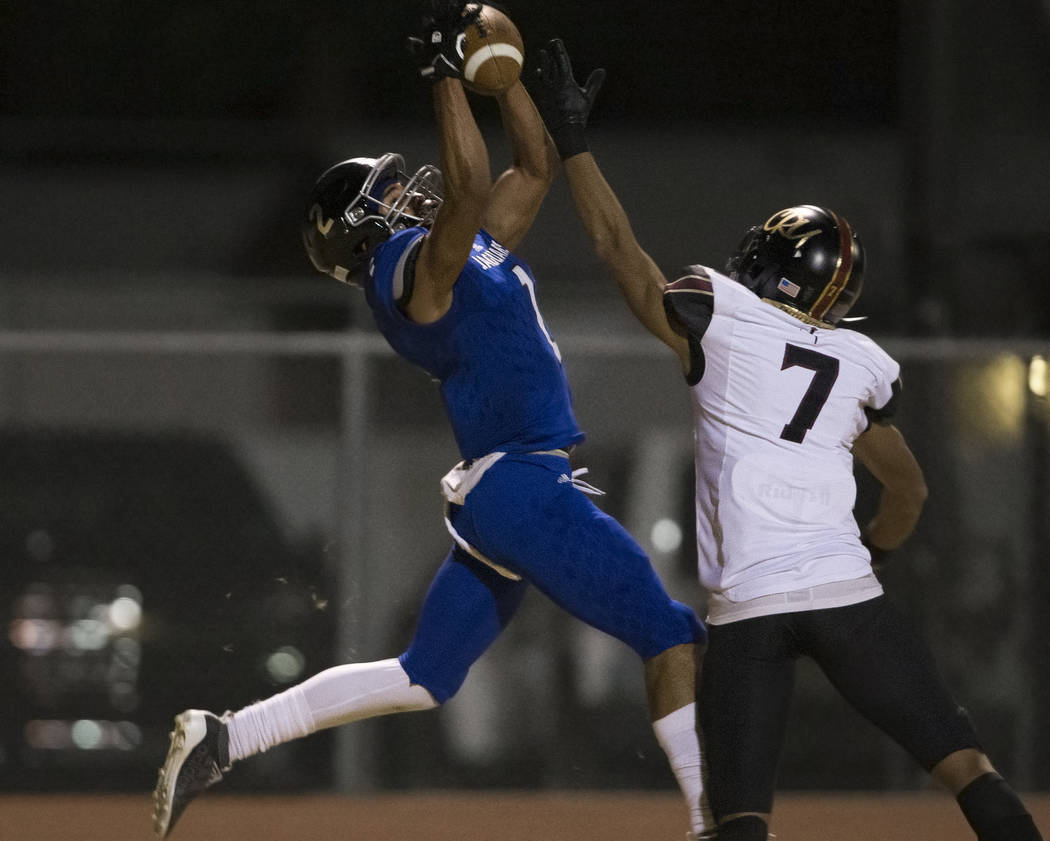 Desert Pines freshman wide receiver Deandre Moore (2) makes a leaping touchdown catch over Fait ...