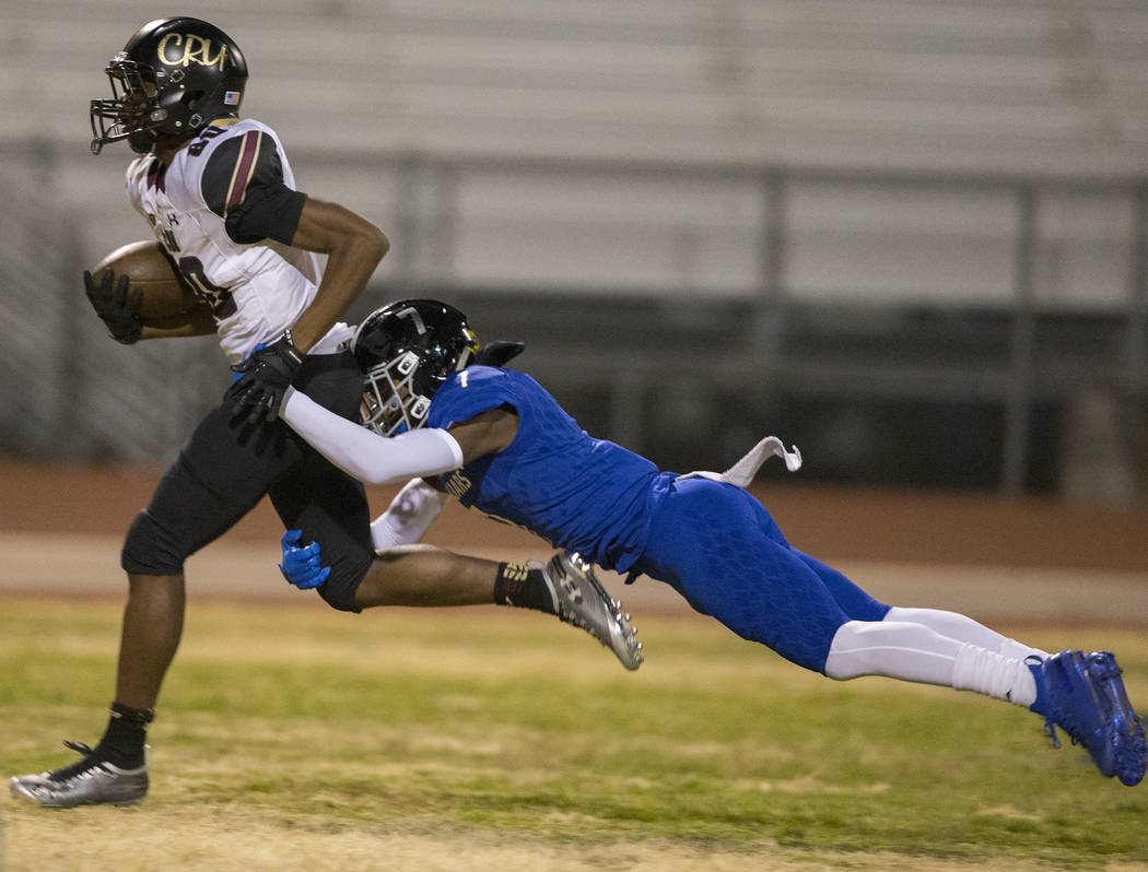 Faith Lutheran junior wide receiver Quenton Rice (80) sprints towards the end zone with Desert ...
